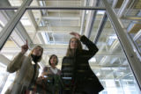 From left to right, Tiffany Tauscheck, Megan Kasperbauer and Michelle Gee watch from a skywalk...