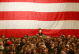 A young girl beneath a flag at the party for Barack Obama after winning the Iowa caucus at the...