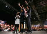 Barack Obama greets his supporters with (from left) his daughter Malia, 9, wife Michelle Obama and...