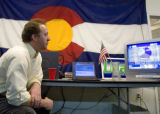 DM0291   Doug Young watches the results of the Iowa Caucuses at the Colorado Democratic Party...