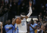 Denver Nuggets forward Carmelo Anthony hold up a triumphant no. 1 finger in the air after the...