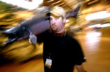 (DENVER, Colo., Nov. 7, 2005) Tony Milakis,(cq),  of Bass Pro Shop's, imaging department, carries...