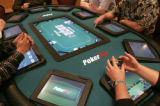 SH08A141AUTOMATEDPOKER Indio, Calif., Jan. 18, 2008 -- Patrons play an electronic version of Texas...