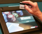 SH08A139AUTOMATEDPOKER Indio, Calif., Jan. 18, 2008 -- A patron wins a hand during an electronic...