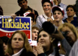 A group of kids cheer on Chuck Norris who appeared with Gov. Mike Huckabee at an event in Concord,...