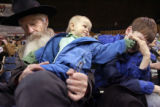 (from left) Gary DeFries (cq), from Breckenridge, Colorado, prays while his 18-month-old...