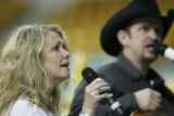Bill and Sammy Snow (cq), singers from the Christian Cowboys in Colorado Springs perform at the...