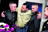 Before leaving for the airport to receive his son's body, Jeff Cathey hugged two of his 2nd Lt....