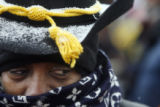 Diane Holimam (cq), from The Buffalo Soldiers of the Rocky Mountains,  hides her face from the...