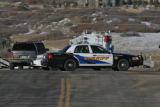 A Douglas County Sheriff car blocks Westbound Happy Canyon, for a crime scene, Monday morning,...