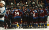(Denver,CO,Shot On 4/28/04-- The Colorado Avalanche huddle after captain joe Sakic scored the game...