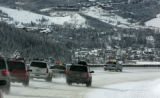 Two Colorado State Patrol cars lead westbound traffic on I-70 into Silverthorne Monday January...