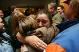Kim Langren (facing) (cq) hugs Theresa Cromer (cq) as family gathers in the doorway of courtroom...