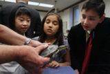 (from left) Skyline Vista Elementary School students 10-year-old Amy Loi (cq), 9-year-old Sabrina...