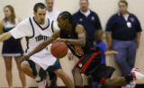Ridgeview High School's Justin Clark drives past Thunder Ridge High School's  Mike McClelland...