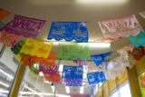 Party flags hang at the enterance of Avanza market at 1320 S. Federal Blvd., Denver, Colo., on...