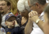 Denver, Colo., photo taken May 30, 2004-Zachary Dutton,2, sits with his grand parents Jim and...