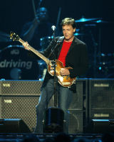 (NYT34) EAST RUTHERFORD, N.J. -- April 18, 2002 -- MCCARTNEY-CONCERT-REVIEW -- Paul McCartney wore...