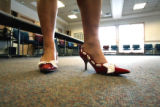 Jeanette Rojas (cq), 2008 Miss Loveland Valentine, shows off her valentine shoes during the...