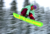 Tucker Andrews does a Indy off a jump in the terrain park at Crested Butte, during training...