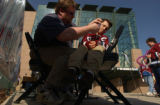 (Denver,CO,Shot On 4/26/04-- Brad Gibson, 6, has an Avalanche logo painted on his cheek by Ray...