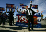 Denver Mayor John Hickenlooper shows his enthusiasm for Refs C & D at the corner of Speer...