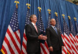 (Denver, Colo., June 1, 2004) Colorado Governor Bill Owens, left and President George W. Bush...