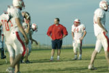 Keenesburg, CO Oct. 27, 2005 Coach Mike Brown, center, conducts practice at Weld Central high...