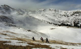 A group of snowboards make their way across the Continental Divide Tuesday morning November 8,...