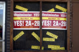 Signs urging voters to reject the building of a Wall-Mart at 72nd Ave. and Sheridan Blvd. are...