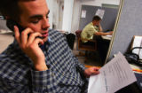 No on C and D volunteer Jeff Small (cq), 23, of Lakewood calls likely conservative voters to get...