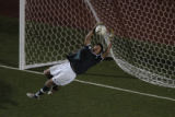 Miguel Rosales, goal keeper for Smokey Hill High School stops a shot in the first half of 5A...