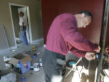 Mark  Cohen (cq) works on some trim work  at the Crossroads Outreach Center, near Myrtle and...