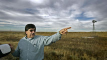 Farmer's Reservoir and Irrigation Company general manager Manuel Montoya of Greeley points out a...
