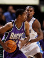 (DENVER, Colo., Oct. 26, 2005) Denver Nuggets, Earl Watson, #8, (cq-roster) covers Milwaukee Bucks...