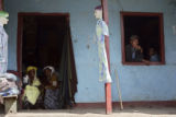 A group of ethiopians sit in the doorway and window of a small shop in Butajira, a city 7 miles...