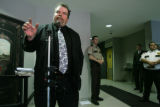 Araphahoe County Deputy District Attorney John Franks talks at a press conference in the lobby of...