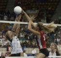 (Lt. to Rt.) 5-foot-5-inch tall Mountain View School's Megan Roark number 3 blocks 6-foot tall...