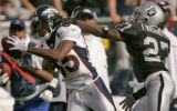 Denver Broncos wide reciever Ashley Lelie,left, makes good on a 41-yard reception being defended...