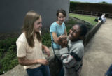Paige Roberts, 17, left, Lauren Tatarsky, 18, laugh with Dershaya, 12, minutes before saying their...