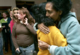 Marta Gabre-Tsadick, founder of Project Mercy, right, gives a hug to Meron Abebe, as the colorado...