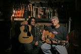 Script writter, Heylar Garcia (CQ), LEFT, and local Guitar maker Scott Baxendale (cq) ,51, sits in...
