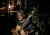 Local Guitar maker Scott Baxendale,51, sits in the Colfax Guitar Shop Friday morning Oct. 21, 2005...