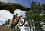 Ryan Berg(cq)  from Colorado Springs rides his dirt bike on the trails along Rampart Range Road in...