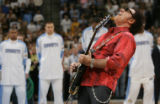 "JPM0456 Neal Schon, guitarist for the band ""Journey"" plays the National Anthem prior to..."