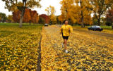 Cheryl Richardson runs through the leaves Wednesday afternoon October 19, 2005 in City Park. The...