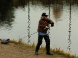 Richard Roche (cq) does some fishing at Evergreen Lake Wednesday afternoon October 19, 2005. Roche...