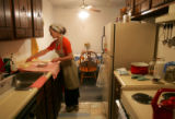 Zuleyha Beshatova makes Turkish bread in her apartment in Denver on October 18, 2005, that she...