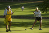 15-year-old golf phenom, Michelle Wie (left) is all smiles on the 17th green with caddy, Jimmy...