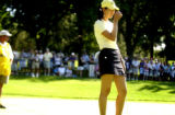 15-year-old golf phenom, Michelle Wie (right) is visibly upset after a boggy on 10, the first hole...